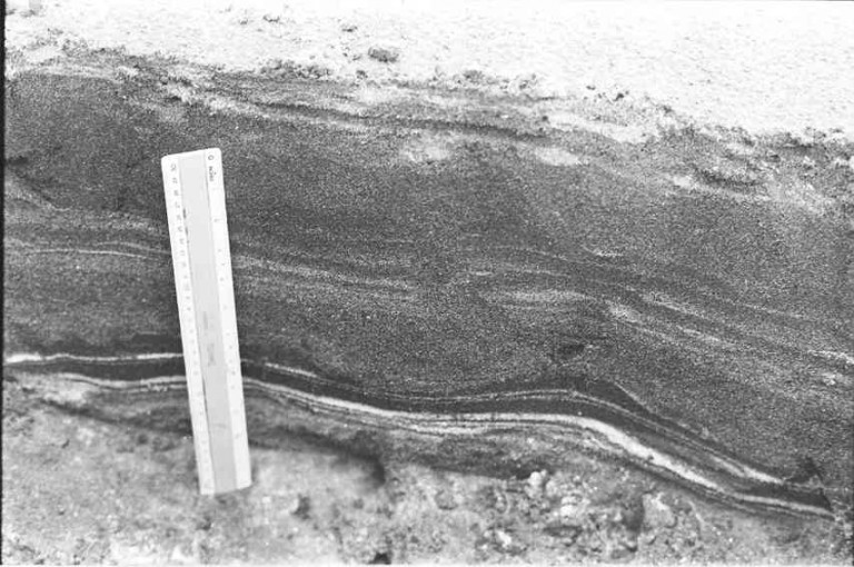 Wavy bed form perhaps an antidune form characteristic of upper flow regime.