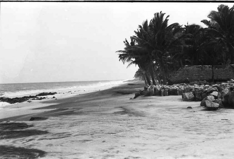 The beach face with a well formed berm was flattened by erosion and a large portion of sediment was washed to back shore. Nly view.