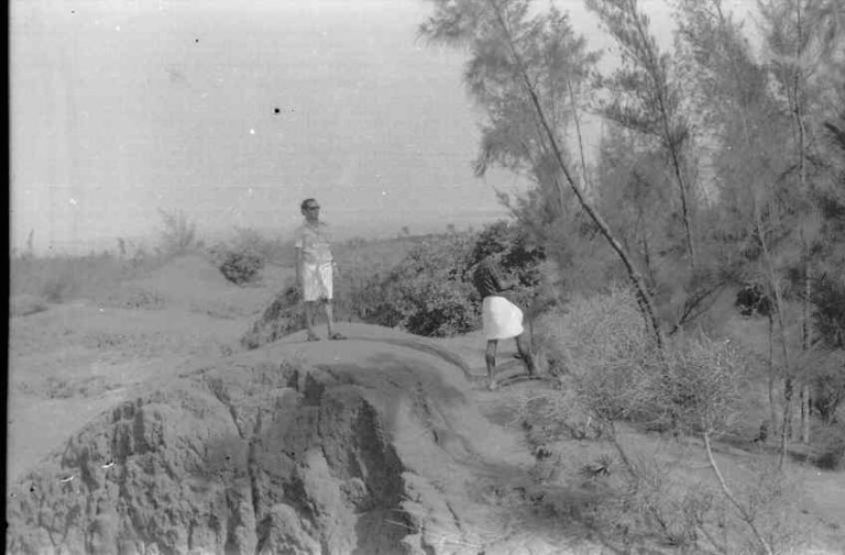 Sarma's brother Lakshmanan curiously looking from a dune crest, 1978