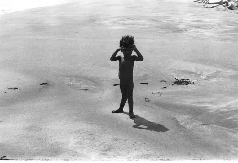 Silhouette of a small kid from the scene of devastation- The suffering probably is ever lasting for him and others of his age. What is recommended is a policy and plan of building multi-family-multistory- housing on concrete stilts for this section of the society and at least 500 m away from the modern shore line.