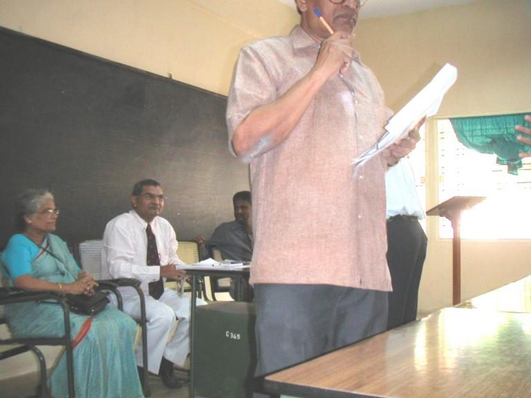 Team member addressing students