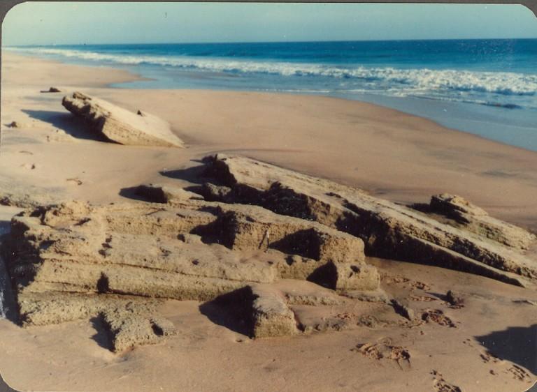 "Beach rocks in Manakudi beach, West of Kanyakumari, Tamil Nadu, India: Kodaslide circa 1978 Scale: Parker jotter in the center is 4.5"" Source Thrivikramji's archives"