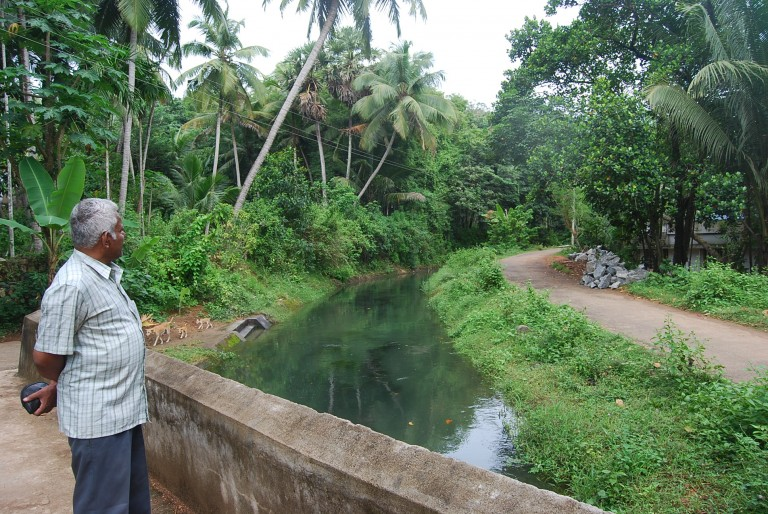 On his way toward Chanikulam, Prof. Mohankumar takes a gaze at the sparkling waters in the canal.