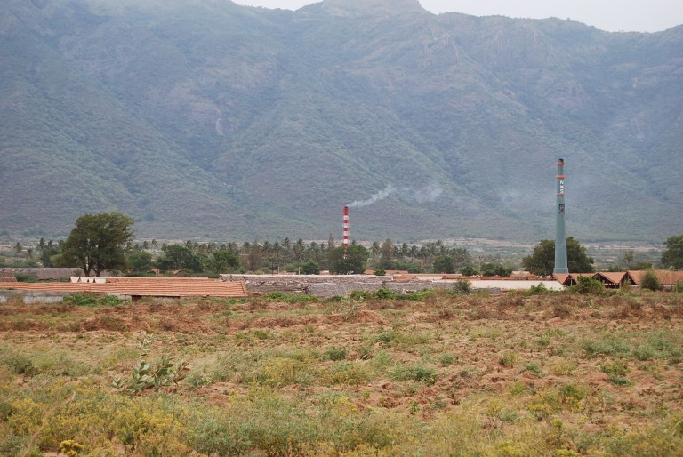 The smoke stacks of the redbrick kilns in the valley which uses the thick colluviam and soil as raw material.