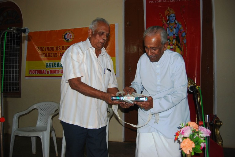 Book is about to be unveiled. ; Dr. Unni helping the Raja