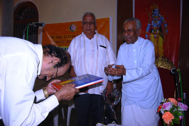 Dr. Sambasivan, a renowned nurosurgen of the town receiving the first copy