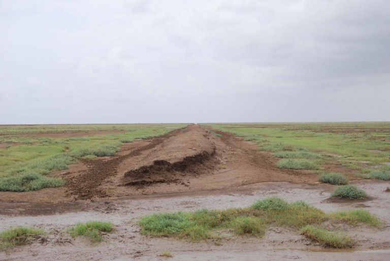A breached road in the flats