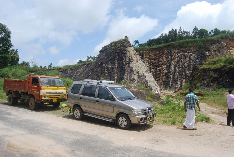Team leaves the car to look at a quarry, Wayanad