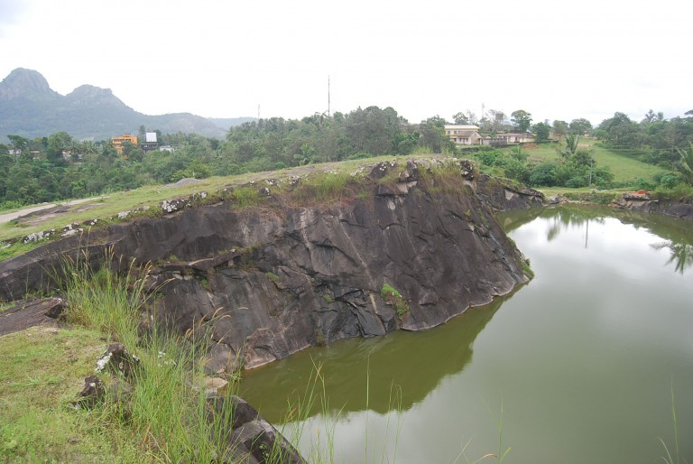 Thadaka Mala in the horizon, pond in the foreground
