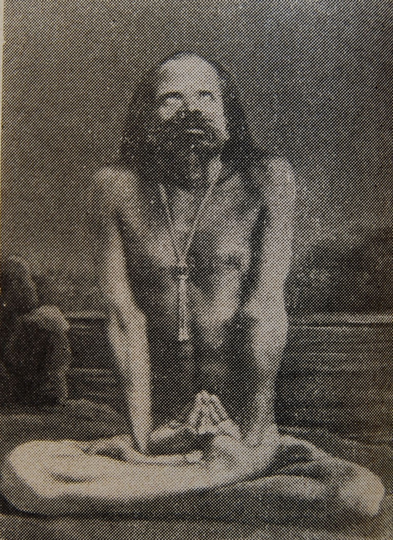 Swami seated in yoga posture