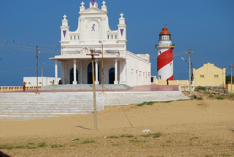 Twin captains  ready to help the humans and the seafarers.The church and light house on top of the Manappad hill