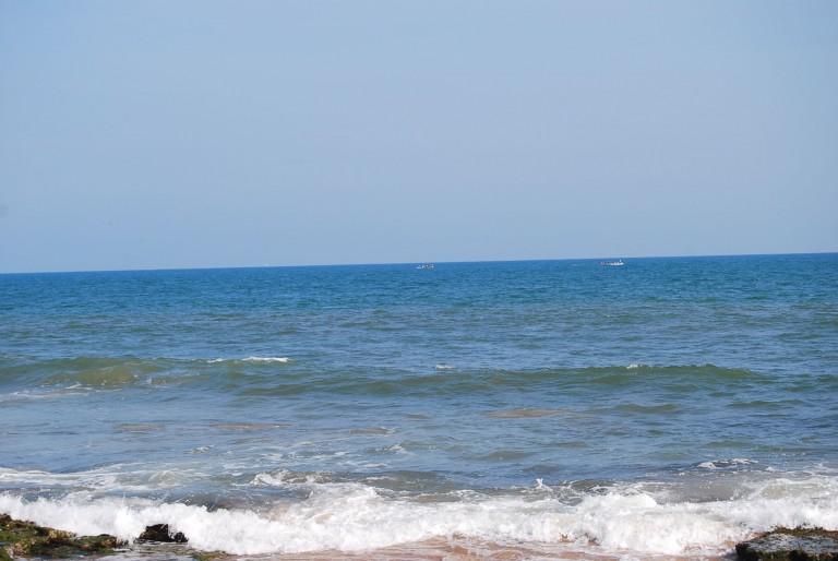 Waves splashing on ledges of Beach rock