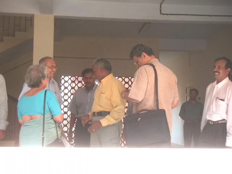 Members talking to Dr Thrivikramji