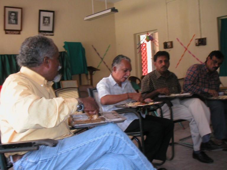 Thrivikramji, Narayanan Nair, Anirudhan and Chacko busy with the food.