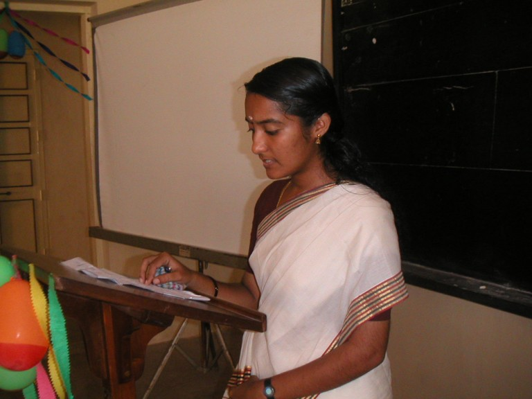 A girl student making some remarks.