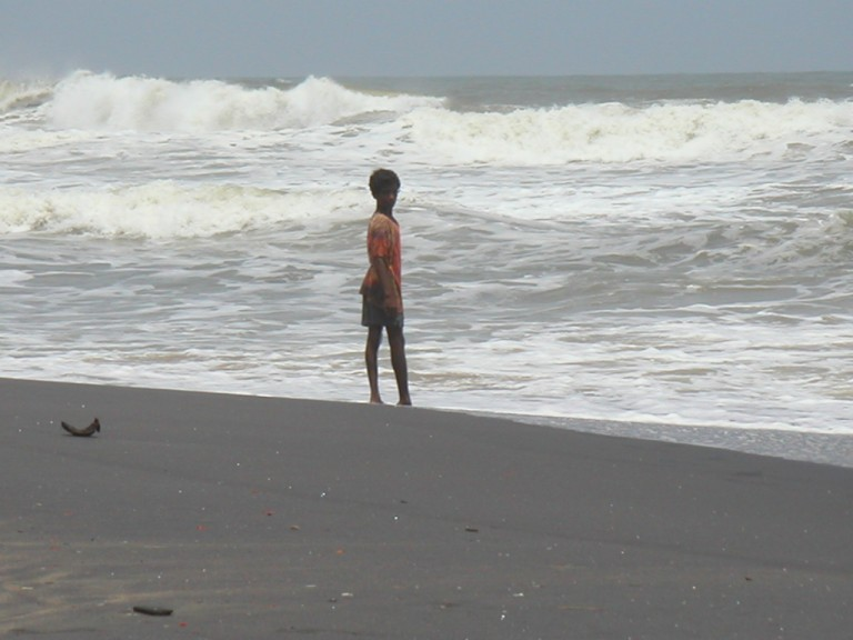 Young lad enjoying the view of furious waves