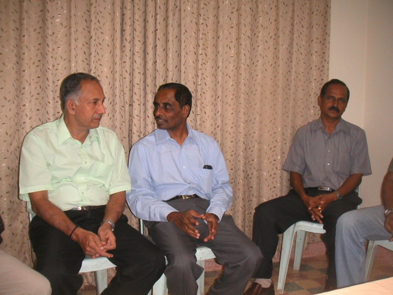 Dr MM Nair and Krishnakumar engrossed in conversation, While Bharathan poses