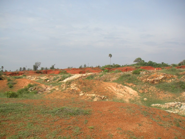 Easterly view of the Teris sitting pretty on the hard lithomarge or even partly altered gneissic rock. Easterly view from Muttom-Kadiapatnam rd.