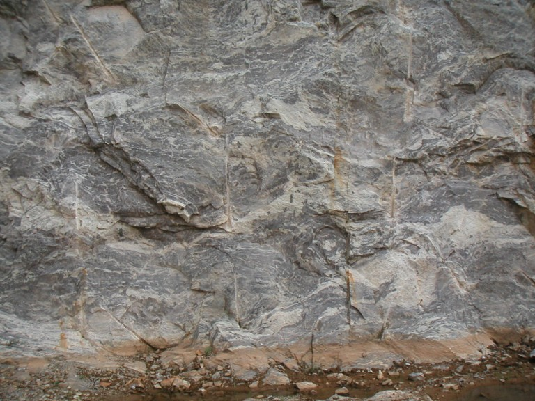 A rock quarry to the east Univ. campus, Kariavattom, in Garnetiferous Biotite gneiss...