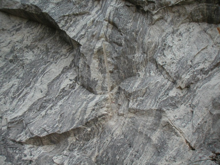 Fresh rock face in the quarry. Also note joints running nearly diagonally from left to right.